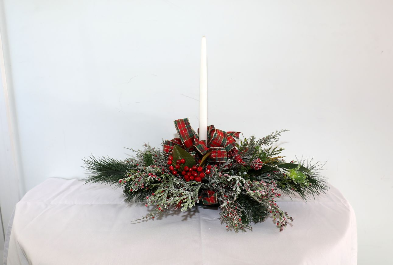 Elongated Centerpiece of Holiday Greens with Silver Decorations