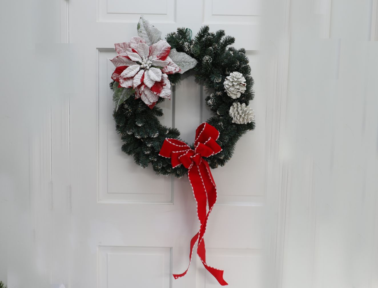Evergreen Wreath with White Cones, Poinsettia and Red Bow | 22 inch